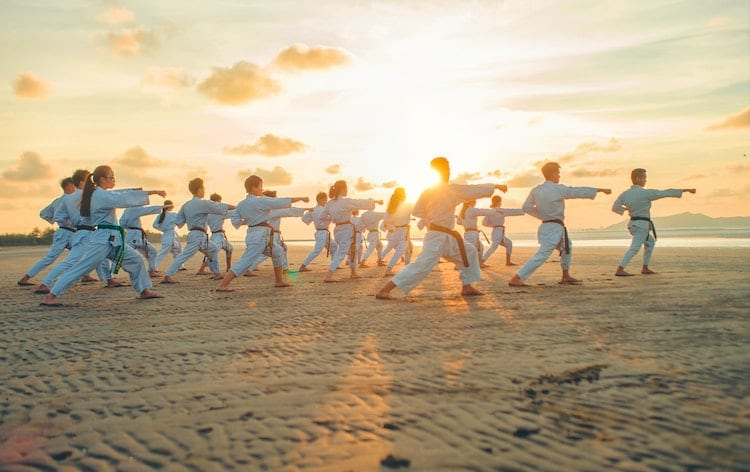 People Practicing Karate on Beach