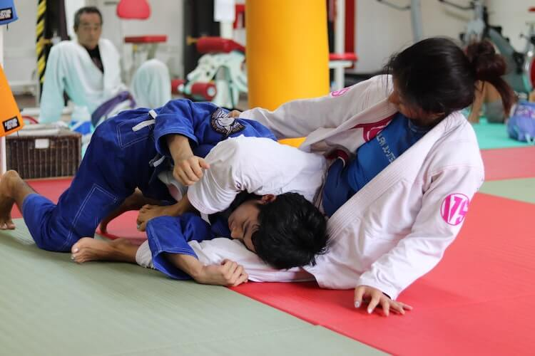 Two women practicing judo